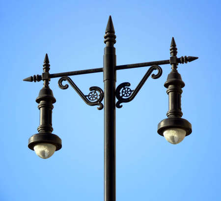 Ornate exterior light fixture, painted black.