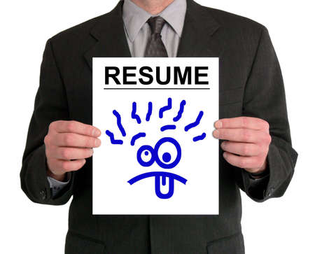 Image of a businessman's torso. He is holding a resume in front of him, with a silly cartoon face drawn on it. Stock Photo