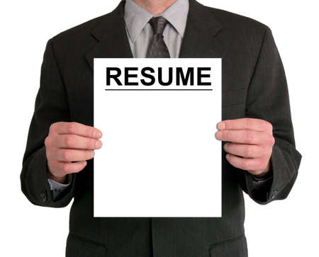 displays: Image of a businessmans torso. He is holding a resume in front of him. Stock Photo