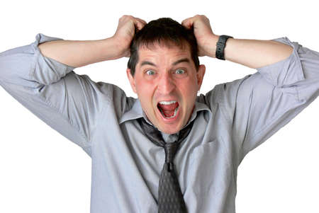 Frustrated businessman, with sleeves rolled up and tie loosened, screaming and pulling his hair. Stock Photo - 417505