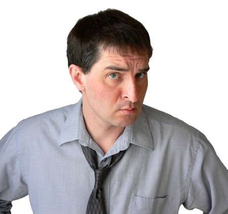 Businessman with tie undone, giving the viewer the eye. Stock Photo - 417499