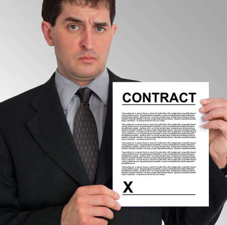 greys: Image of a businessman holding a contract to his left, against a grey gradient background.
