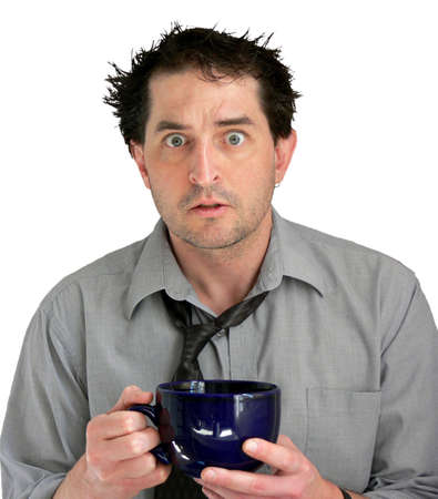 freaked: Tired, freaked-out business man with a big cup of coffee. Stock Photo