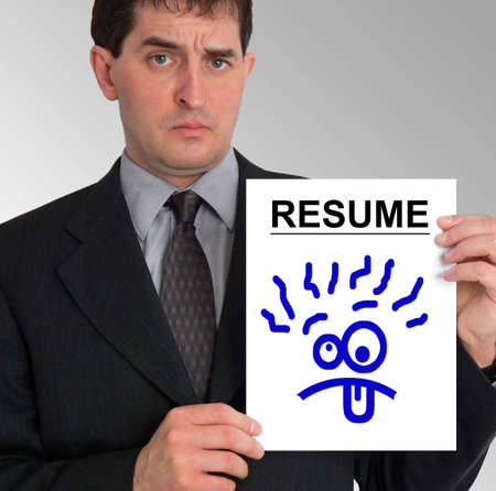 conflicting: Image of a businessman holding a resume to his left, against a grey gradient background. The resume has a blue cartoon drawing of a silly face on it.