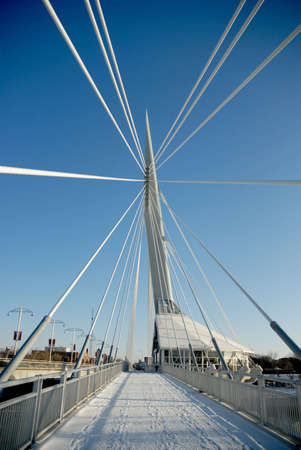 Shot of Provencher Bridge, from the west end facing east, with support cables converging to a focal point.