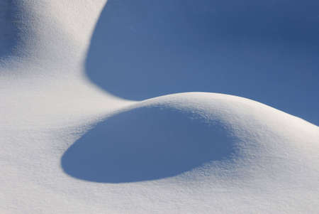 Flowing snow forms in the bottom of a skateboard structure. Stock Photo
