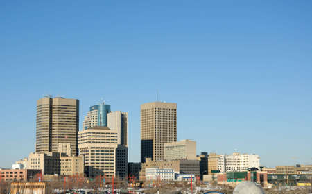 Downtown Winnipeg skyline, with lots of blue sky above.