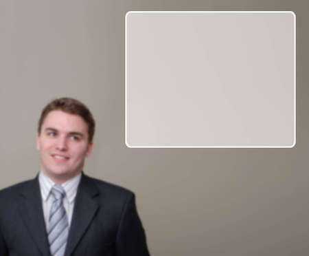 Happy Young businessman blurred in background, with textbox in upper right of image. Stock Photo