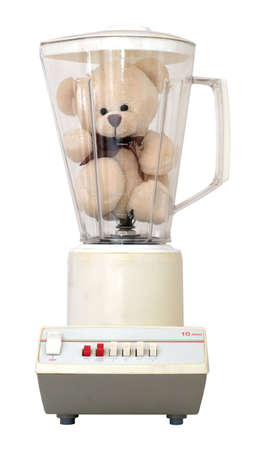 Cute little teddy bear in an old-fashioned blender, isolated on a white background.