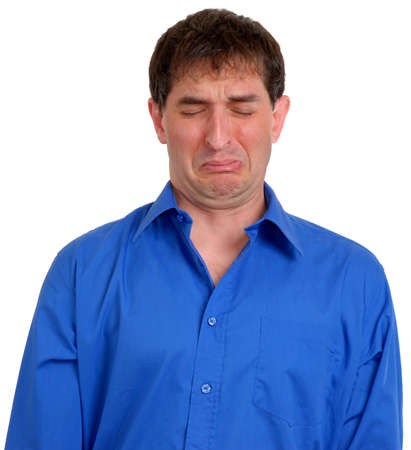 Man in blue dress shirt looking sad or disgusted.