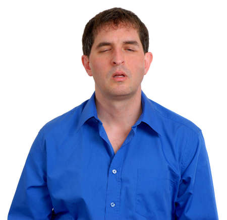 Man in blue dress shirt looking tired.