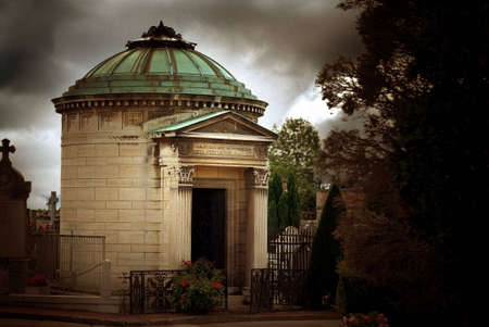 oxidized: Stone mausoleum with oxidized metal roof in an ancient cemetery in France. Image has film grain effect added.