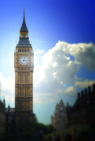 Artistic, painterly image of Big Ben clock tower in London, England, against dramatic clouds. Image has an added effects such as pastel on canvas, blur and lens flare.