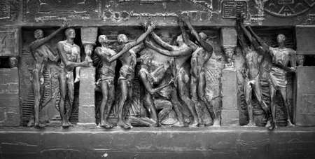 Black and white image showing detail from the Human Rights Monument in Paris, France, near the Eiffel Tower and the Champs de Mars. Image has an added film grain effect. Stock Photo