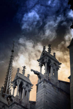 Artistic image showing detail of Notre Dame Cathedral in Paris, France, against a dramatic cloudy sky. Image has an added film grain effect. Stock Photo - 1780856