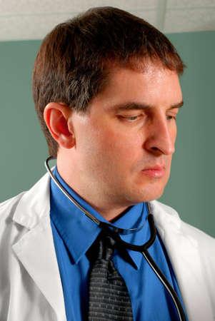Three quarter profile of male doctor. Stock Photo