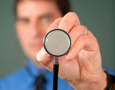 Doctor with a stethoscope, shallow DOF.