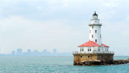 Lighthouse at Navy Pier in Chicago, with skyline visible in background. Stock Photo
