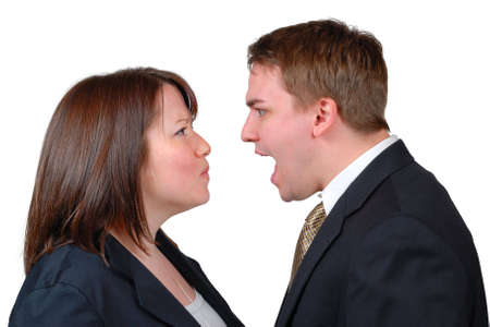 disagreement: Man and woman in business attire arguing. Isolated.