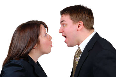 Man and woman in business attire arguing. Isolated.