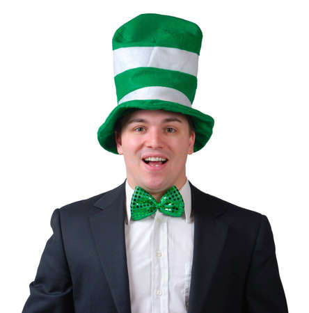Young man wearing suit with green bow tie and green novelty hat for St. Patricks Day. Isolated photo