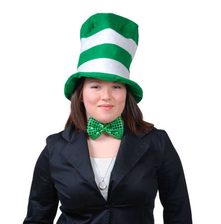 the novelty: Young woman wearing suit with green bow tie and green novelty hat for St. Patricks Day. Isolated Stock Photo