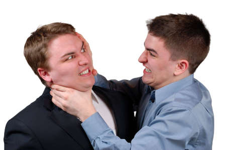 Young man in a dress shirt strangling a young man in a business suit. Isolated