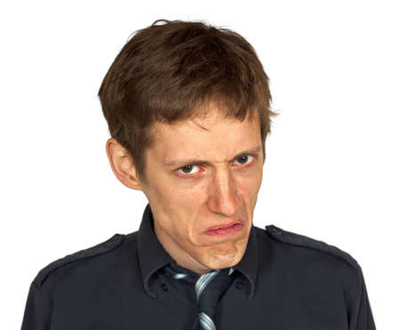 Man in black shirt and tie looking displeased, isolated on white background
