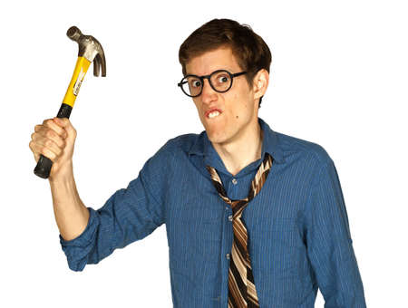 Angry man looking at camera and brandishing a hammer, isolated on white background  Stock Photo