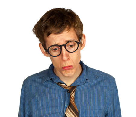 Sad man with glasses, shirt and tie looking down and pouting, isolated on white background  Stock Photo