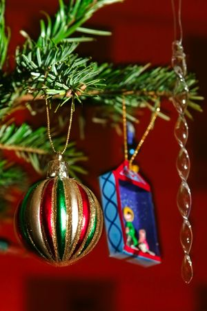 Various Christmas ornaments hung on a tree