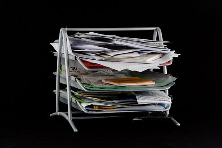 In-basket overflowing with papers,mail and other documents. Isolated on black background. Stock Photo - 2450497