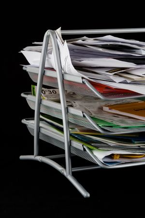In-basket overflowing with papers,mail and other documents. Isolated on black background. Stock Photo - 2450500