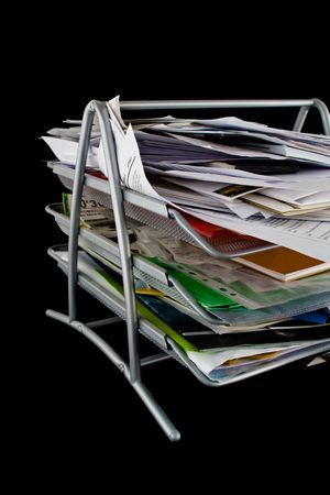 In-basket overflowing with papers,mail and other documents. Isolated on black background. Stock Photo - 2450499