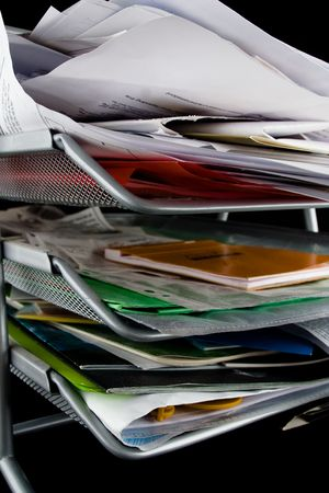 In-basket overflowing with papers,mail and other documents. Isolated on black background. Stock Photo - 2450504