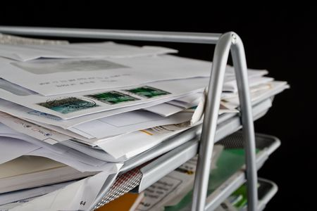 In-basket overflowing with papers,mail and other documents. Isolated on black background. Stock Photo - 2450498