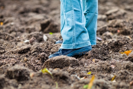 shoes off: Walking through a Ploughed Soil Wearing Boots in the Autumn