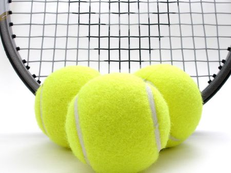 raquet: three tennis balls and raquet
