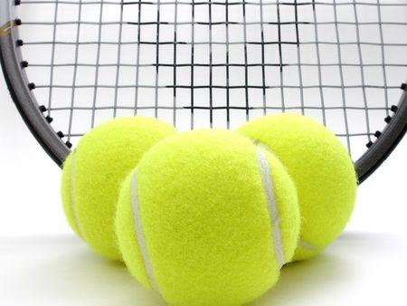 raquet: three tennis balls and raquet