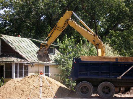 dumptruck: beginning to demolish an old house