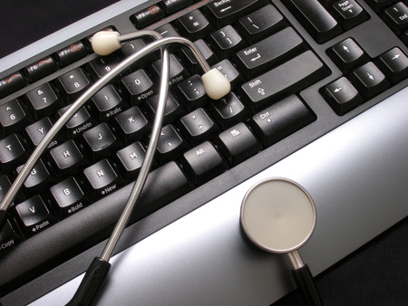 stethoscope and keyboard on desk