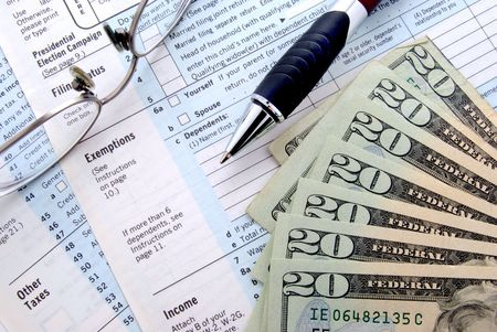 tax forms and money Stock Photo