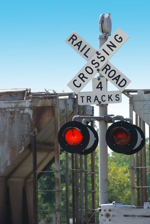 heavy industry: railroad crossing and train Stock Photo