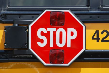 sign: stop sign on bus