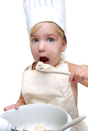 a young girl baking cookies