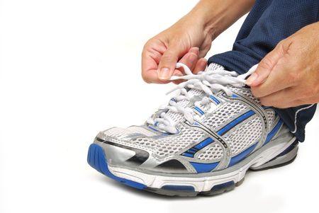 tying a tennis shoe photo