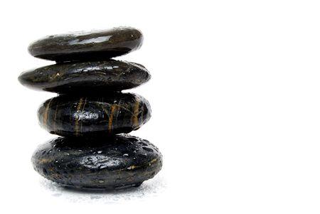 balanced rocks: spa stones on white background