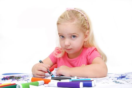 child coloring on paper photo