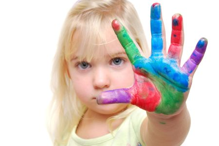 child with paint on hands Stock Photo