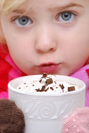 chocolate shavings: close up of little girl drinking hot chocolate